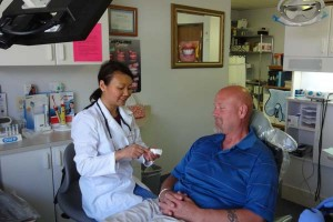 dentist in centennial dr young with patient